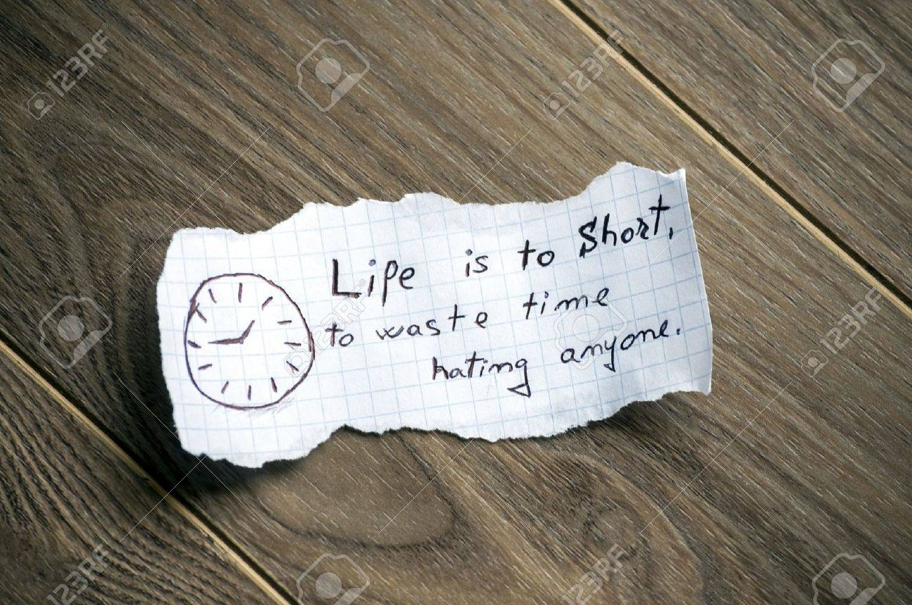 motivational quote written on piece of paper on a wood background motivational quote written on piece of paper on a wood background stock photo