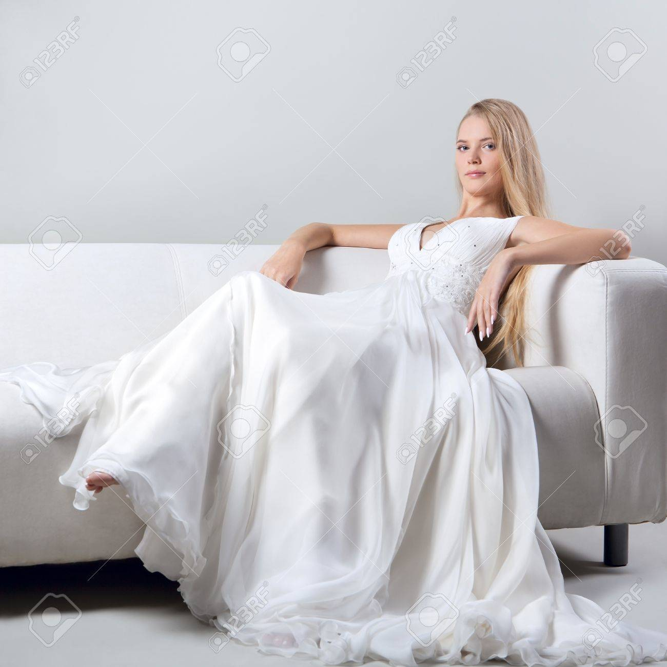 Attractive Beautiful Blonde Girl In A Wedding Dress At The ...