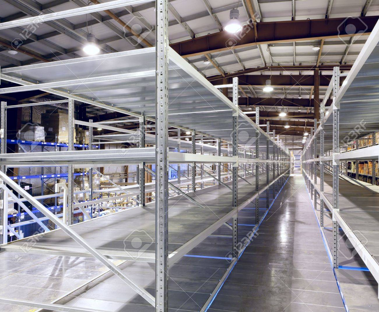 Interior of the new and modern warehouse space in a well lit large room Stock Photo - 19852419