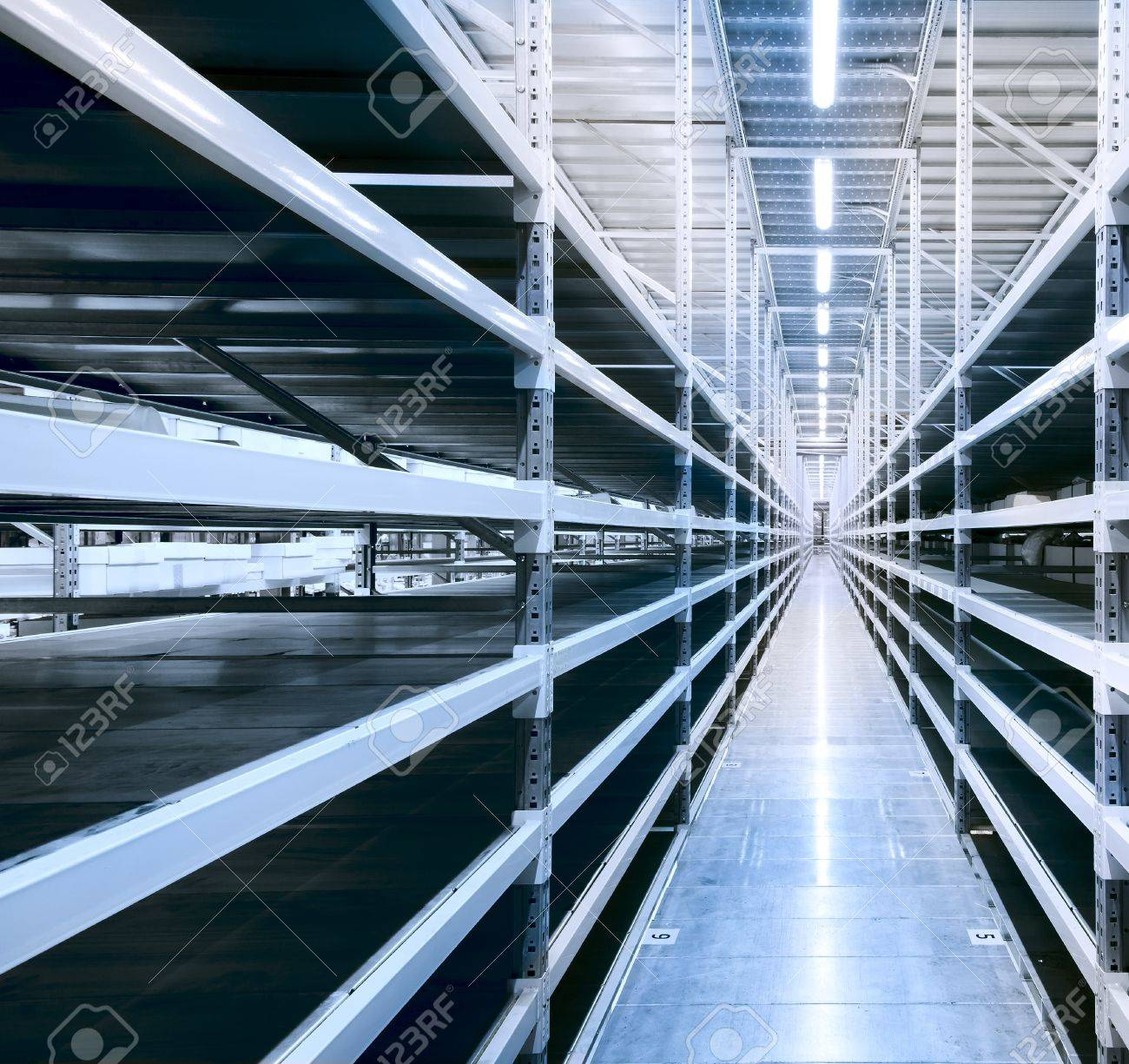 Interior of the new and modern warehouse space in a well lit large room Stock Photo - 19852416
