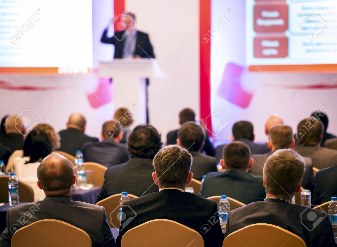 Speaker on the podium. People at the conference hall. Rear view Stock Photo - 24209300