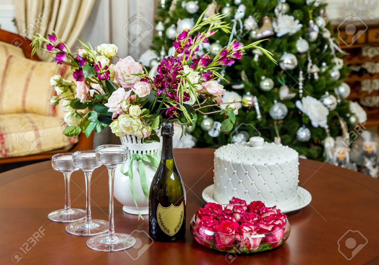 Festive table decorated with a vase of flowers candlesticks festive table decorated with a vase of flowers candlesticks and a bottle of champagne reviewsmspy