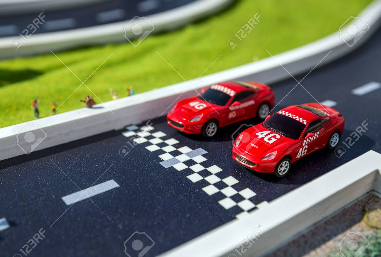 Toy Sport Cars On A Breadboard Two Reds Racing Cars On Race