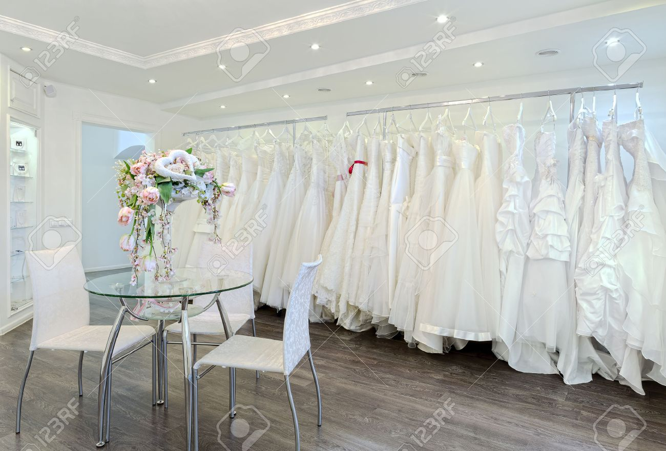 Collection of wedding dresses in the shop - 51753734