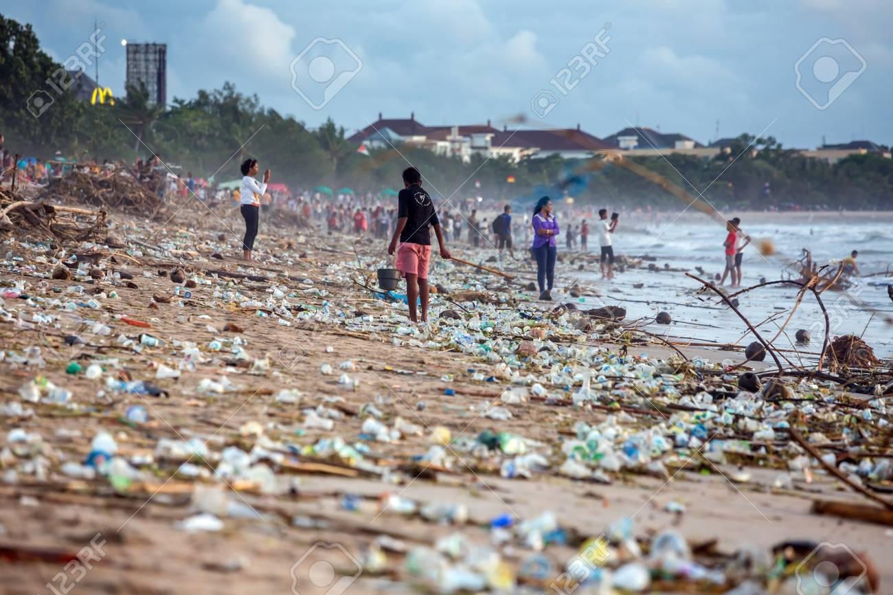 BALI, INDONESIA - FEBRUARY 12, 2017: Beach pollution at Kuta beach, Bali. Many garbage on the beach - 111244825
