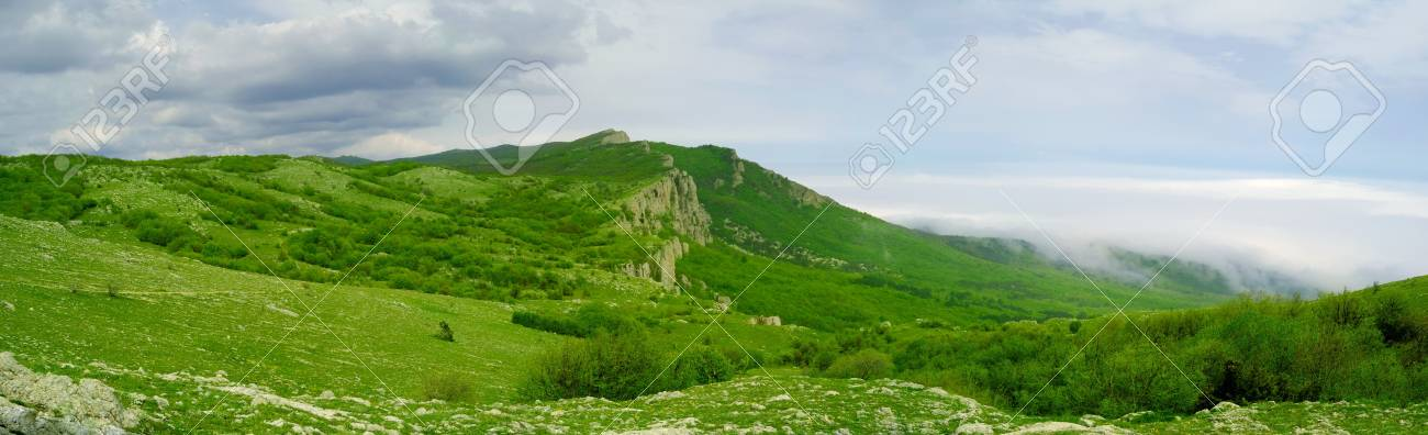 Panorama of Beautiful Mountain Landscape with Low Clouds Stock Photo - 7266523