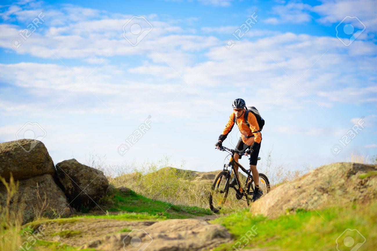 Cyclist Riding the Bike on the Beautiful Spring Mountain Trail - 25067632