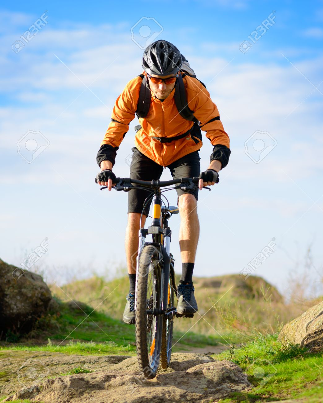 Cyclist Riding the Bike on the Beautiful Spring Mountain Trail - 25067634