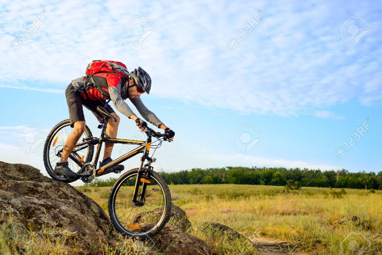 Cyclist Riding the Bike Down Rocky Hill. Extreme Sport Concept. - 44243281