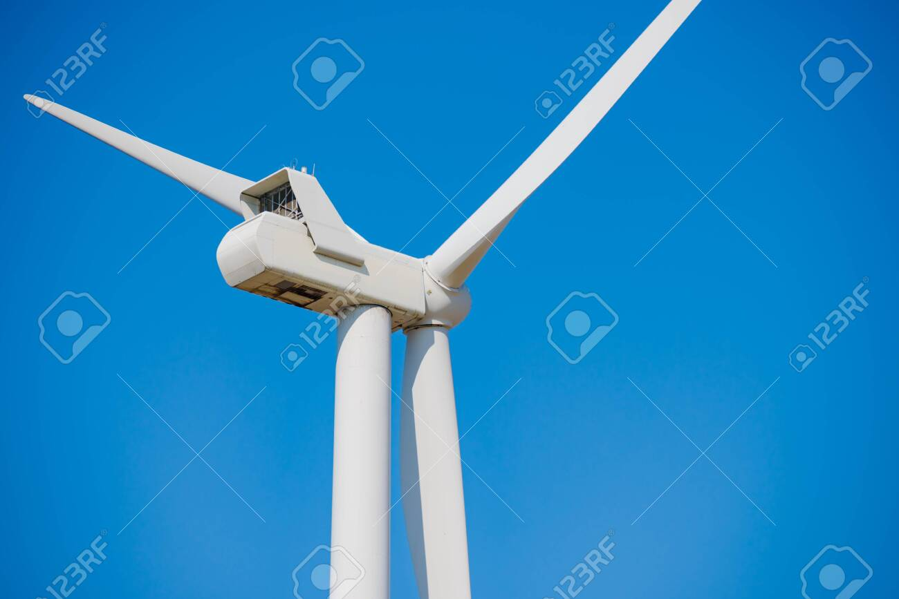Wind Generator Turbine on the Clear Blue Sky Bacground  Green