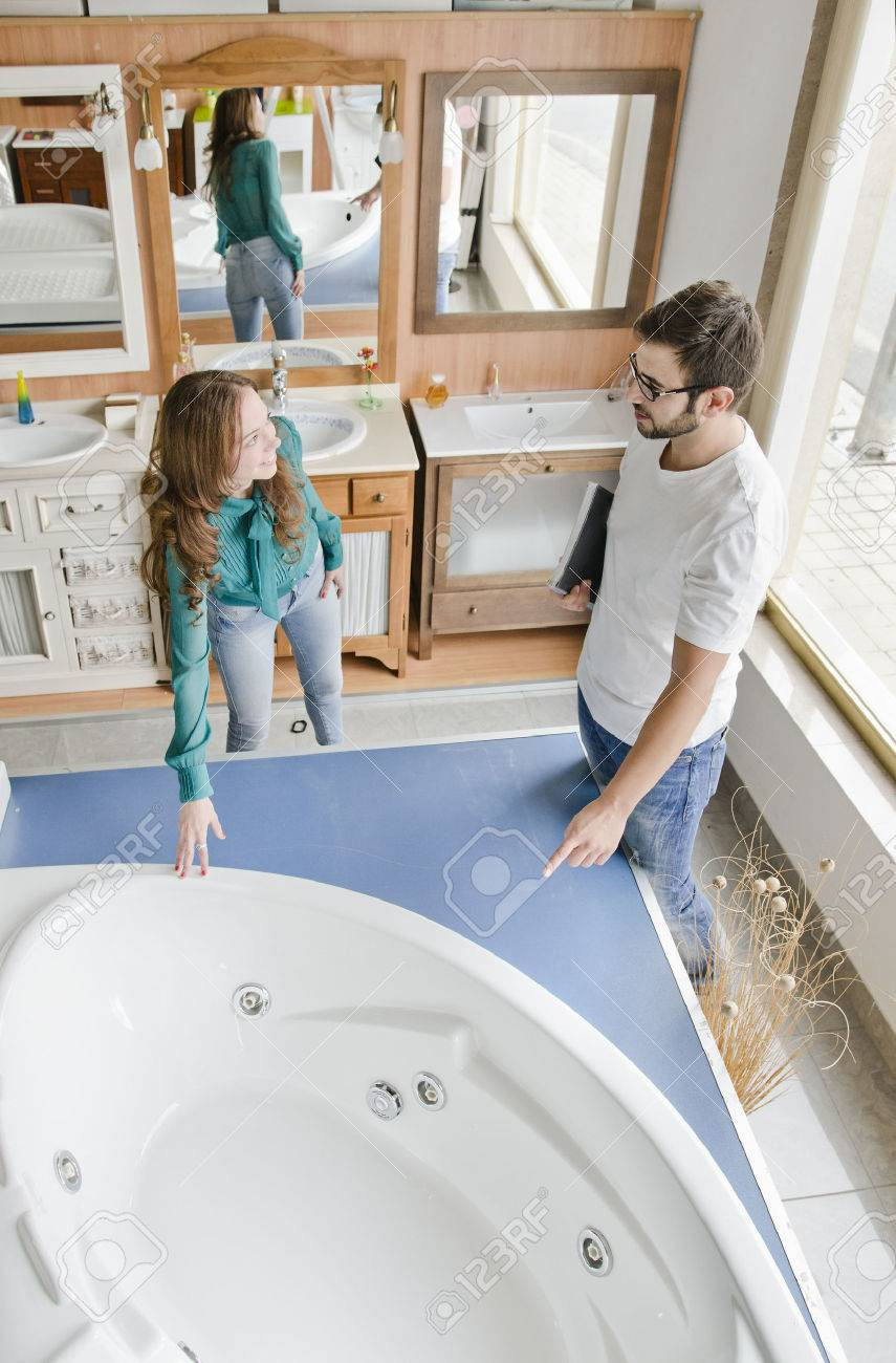 Couple Looking A Hydro Bathtub At Plumbing And Wc Store Stock Photo ...