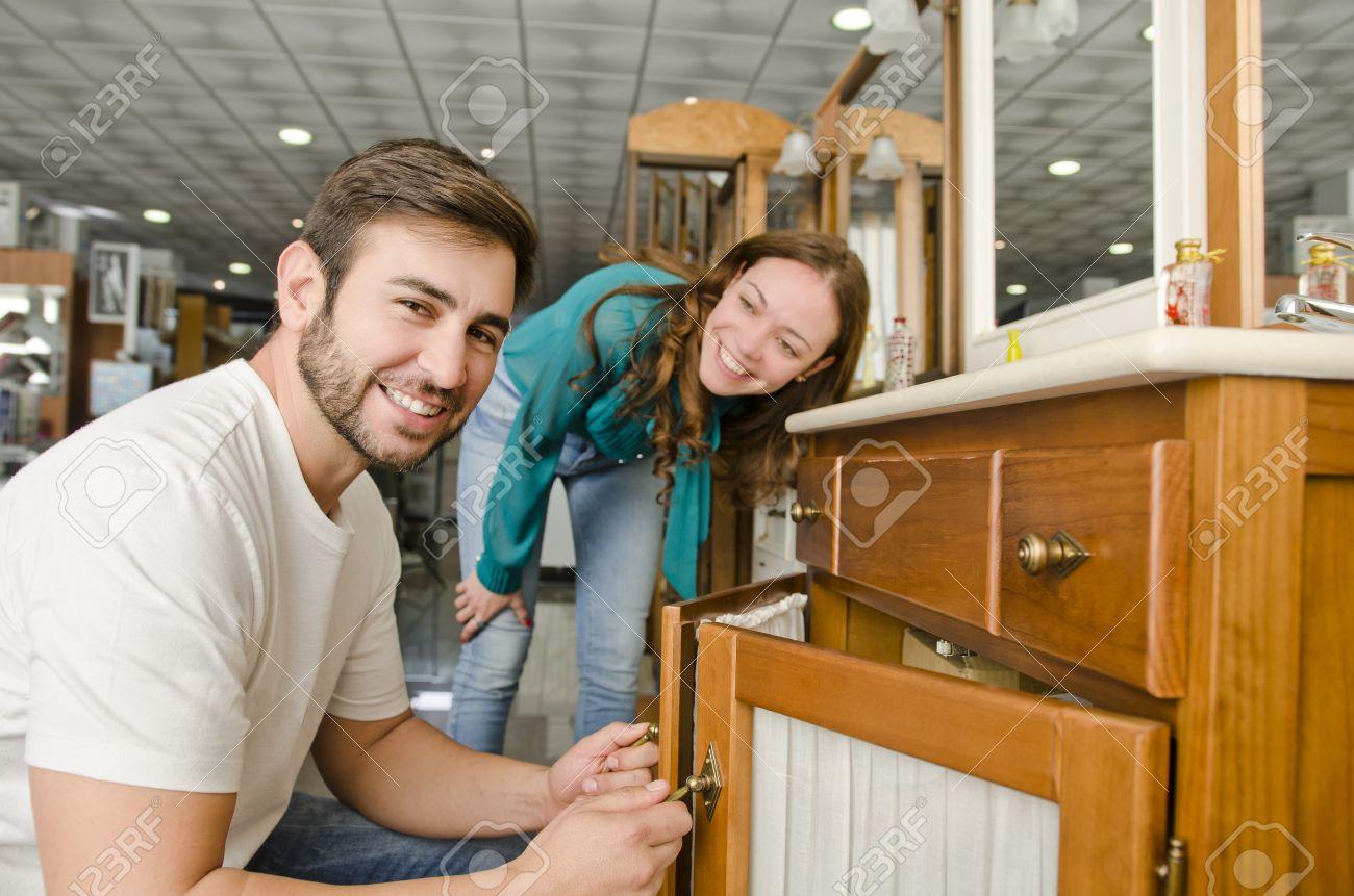 Couple Buying Furniture At Big Plumbing Store Stock Photo