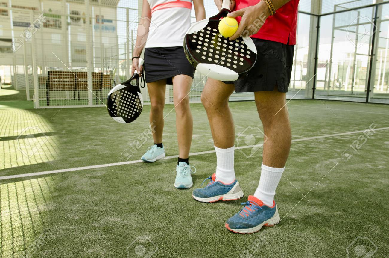 Paddle Tennis Body Parts Of Anonymous Team Couple Stock Photo