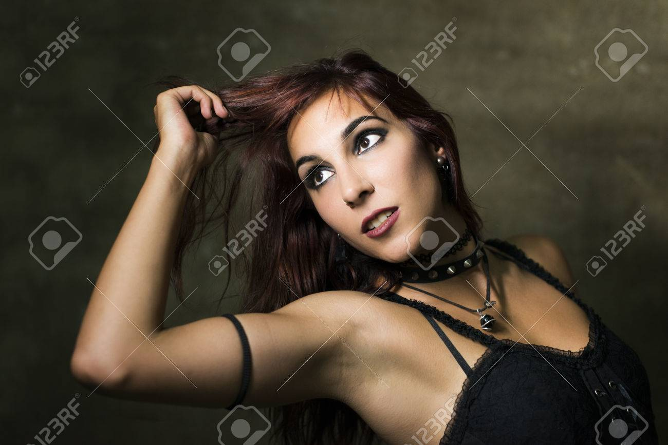 a72559ae056 Stock photo young woman with gothic and heavy metal style and spiked collar  posing on dirty