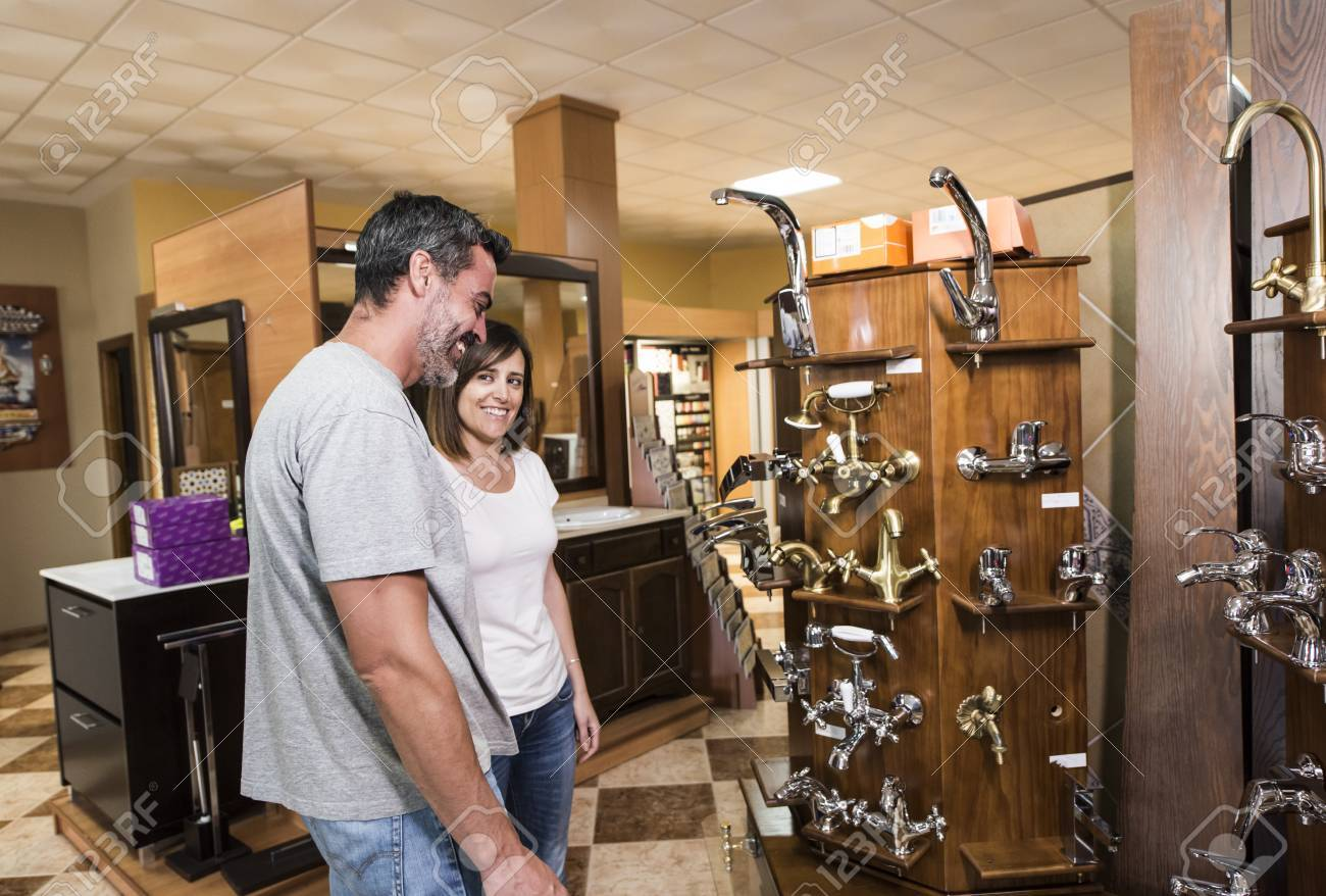 Side View Of Smiling Couple Of Adults Choosing Best Faucet In ...
