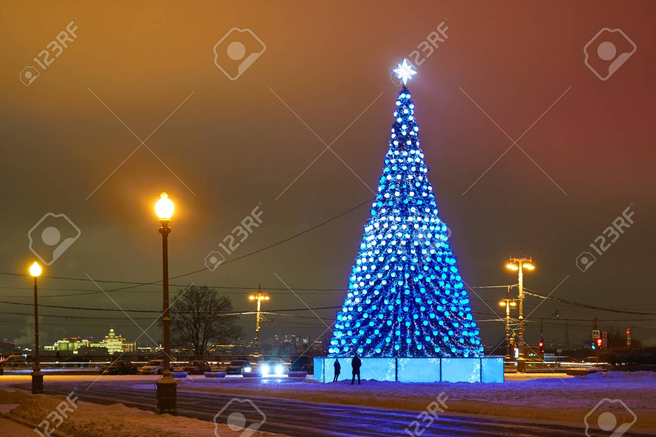 Christmas Tree With Lights In The Foreground And Artificial Northern