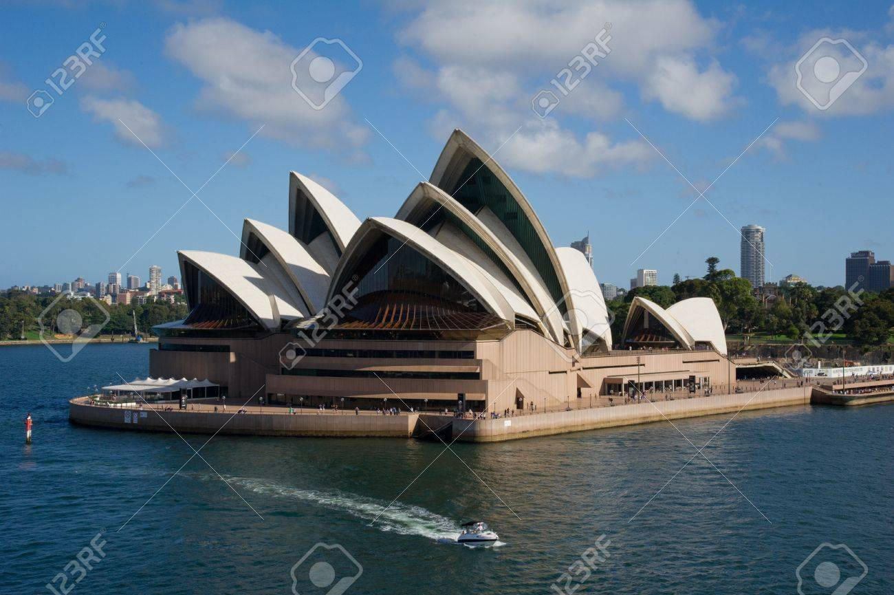 SYDNEY - DECEMBER 24: Sydney Opera House viewed from the ship on December 24, 2011 in Sydney, Australia. The Sydney Opera House is a famous arts center. It was designed by Danish architect Jorn Utzon.  Stock Photo - 12322242