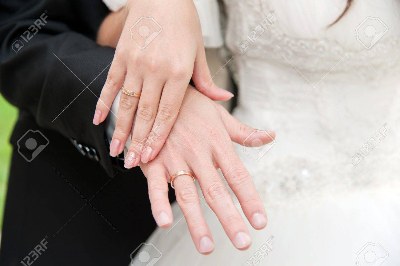 Loving Couple Holding Hands With Rings On The Wedding Day In.. Stock ...