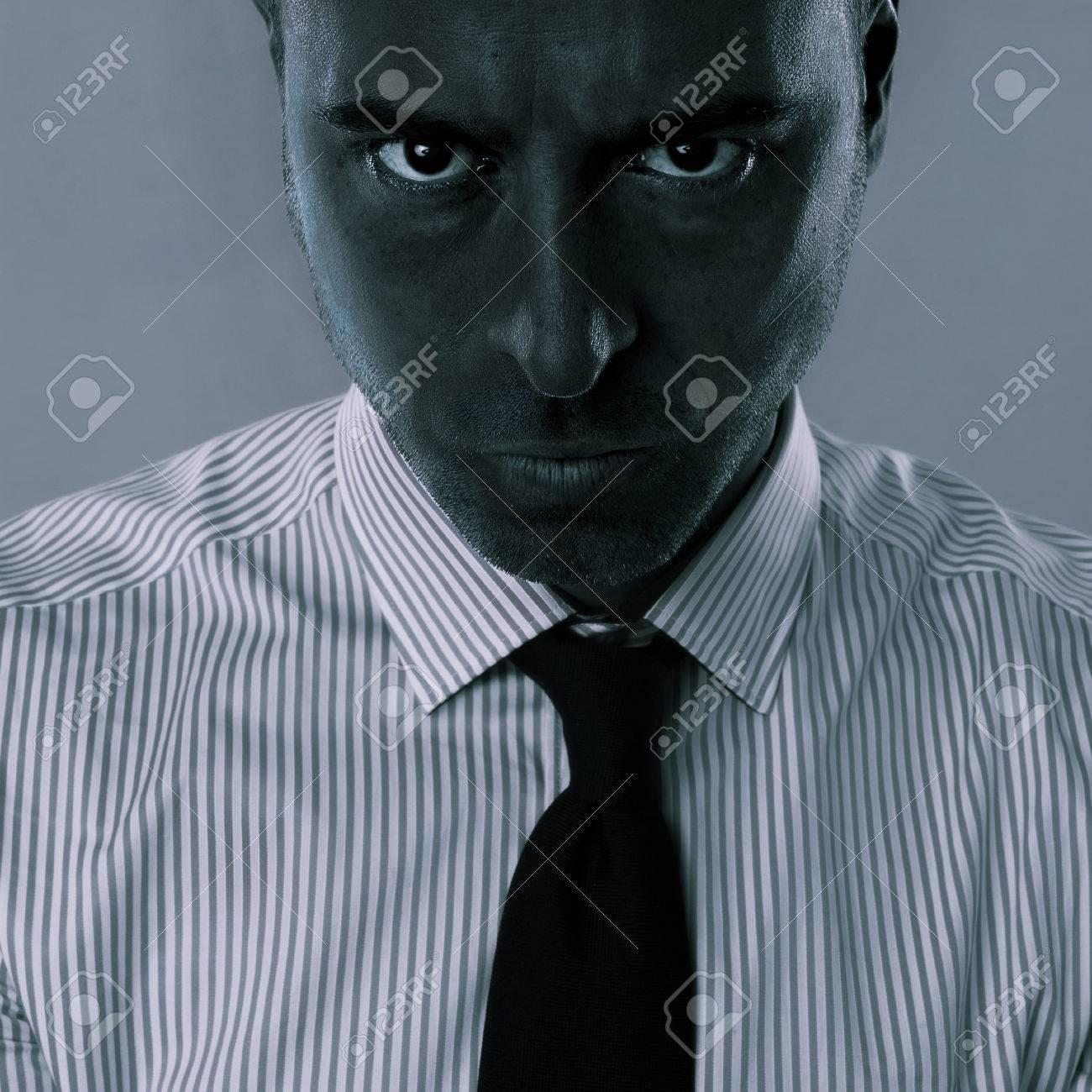 Close Up Portrait Of Angry Emotion On Face Business Man With Black Colored Skin