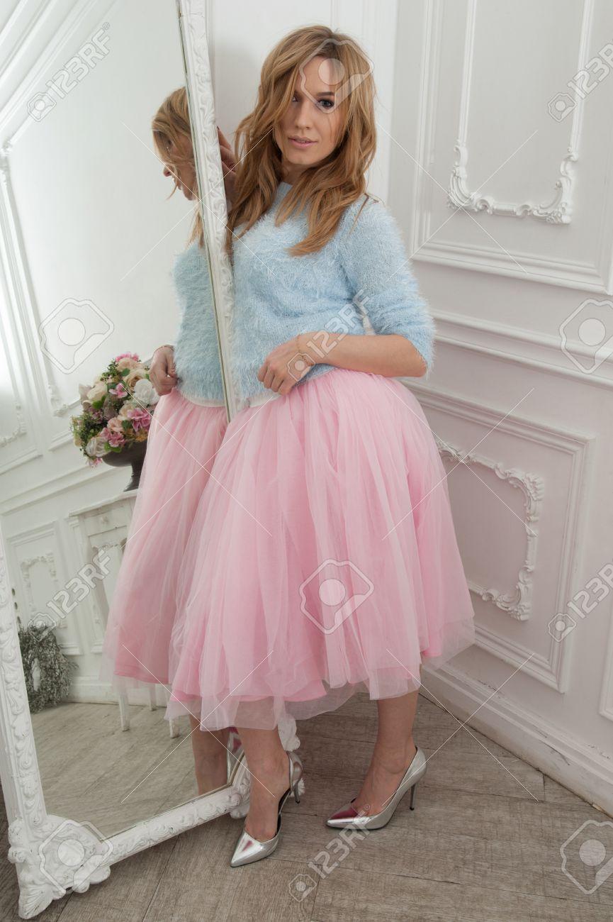 Beautiful Blonde Woman In Pink Skirt