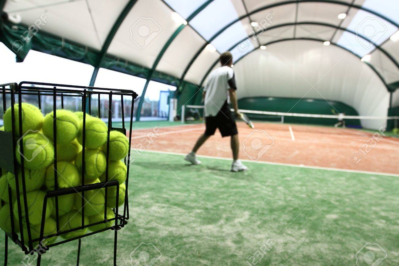Tennis player on the indoor court Stock Photo - 11489070