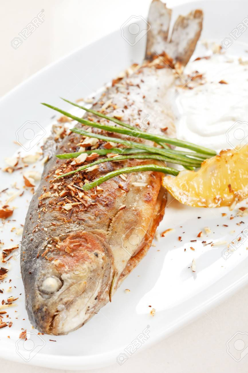 trout fish baked with nuts Stock Photo - 10460575