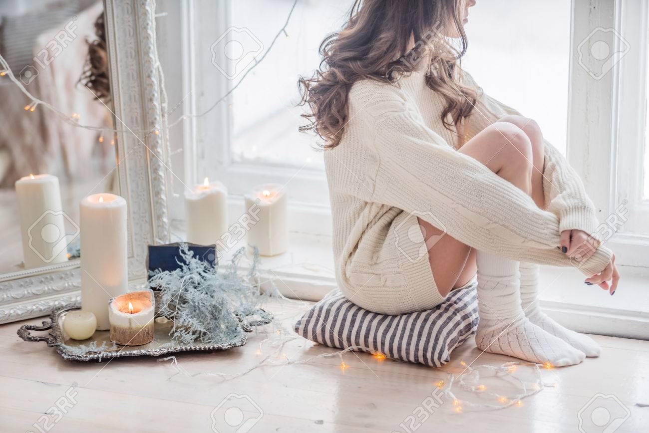 beautiful women relaxing near window - 51666761