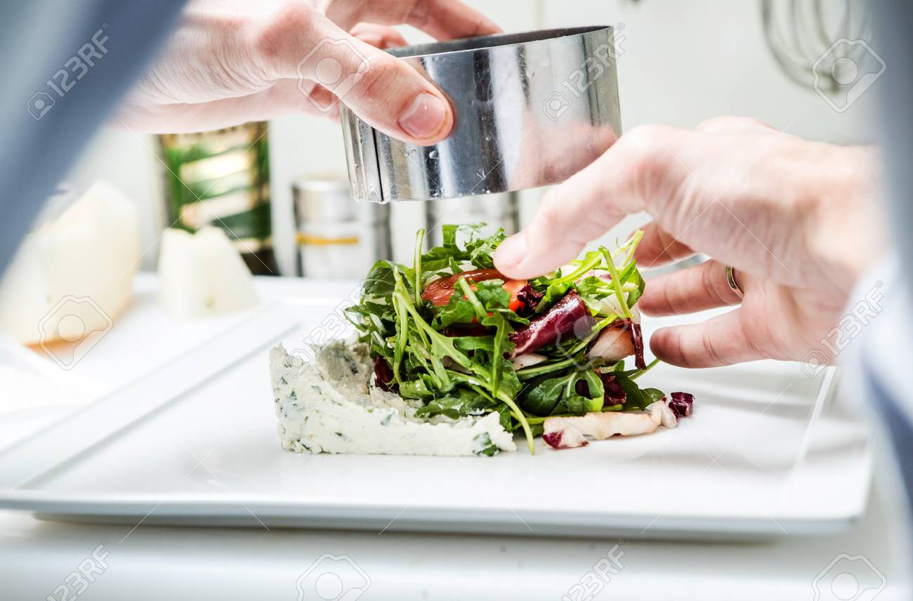 chef at work plating vegetables Stock Photo - 87337322