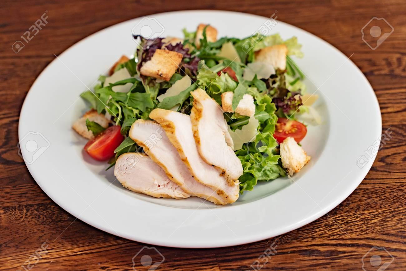 Caesar salad with chicken - 103859373