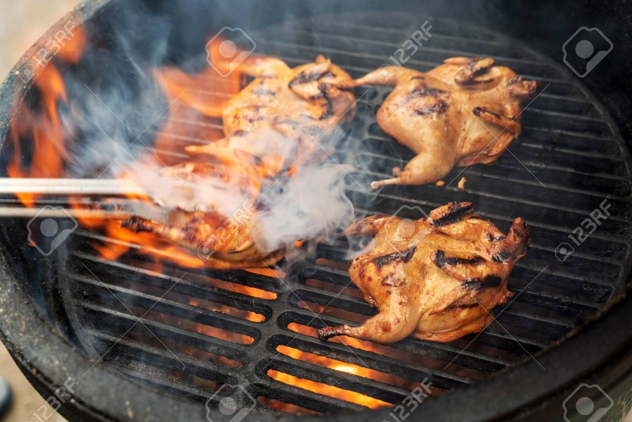 Marinated quail on the grill - 110668369