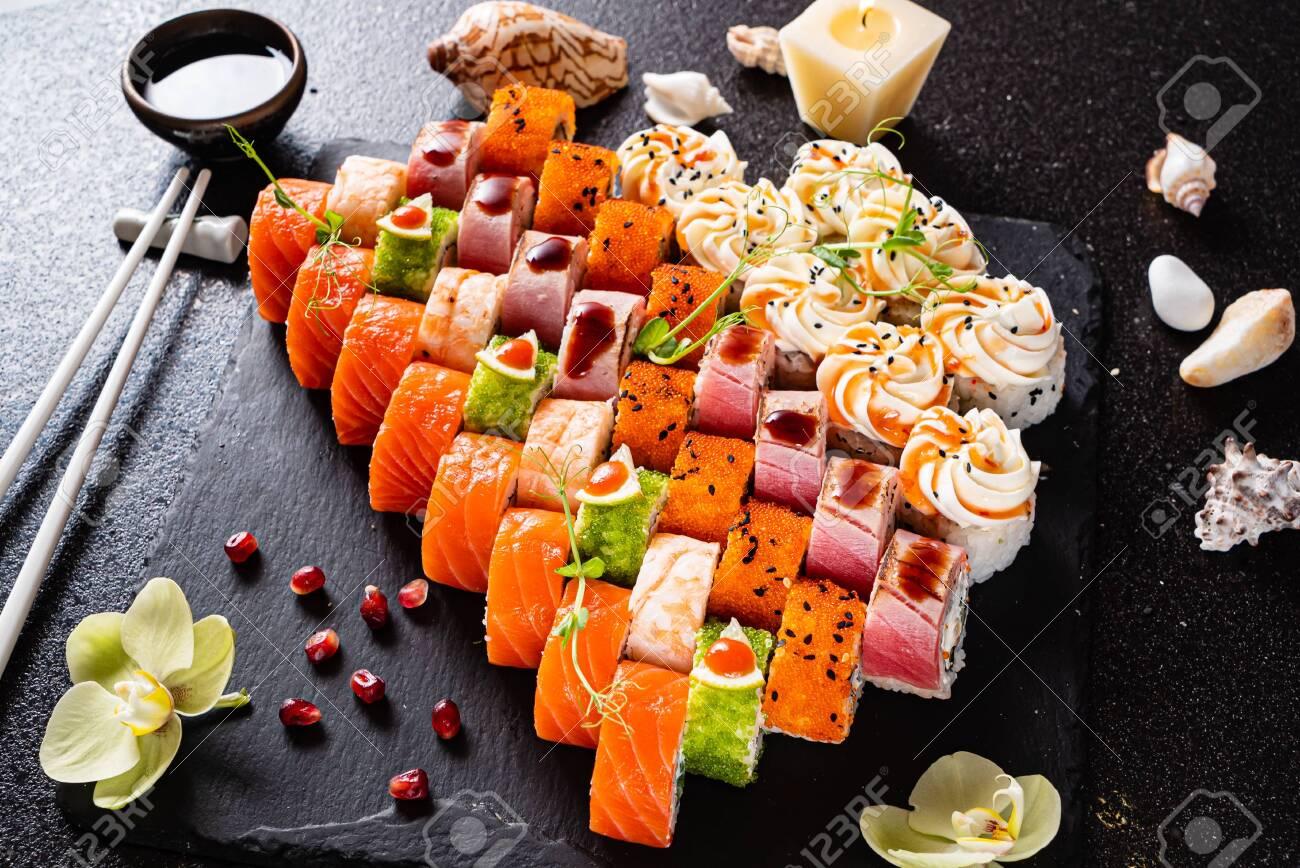 Sushi set on the black - 127239293