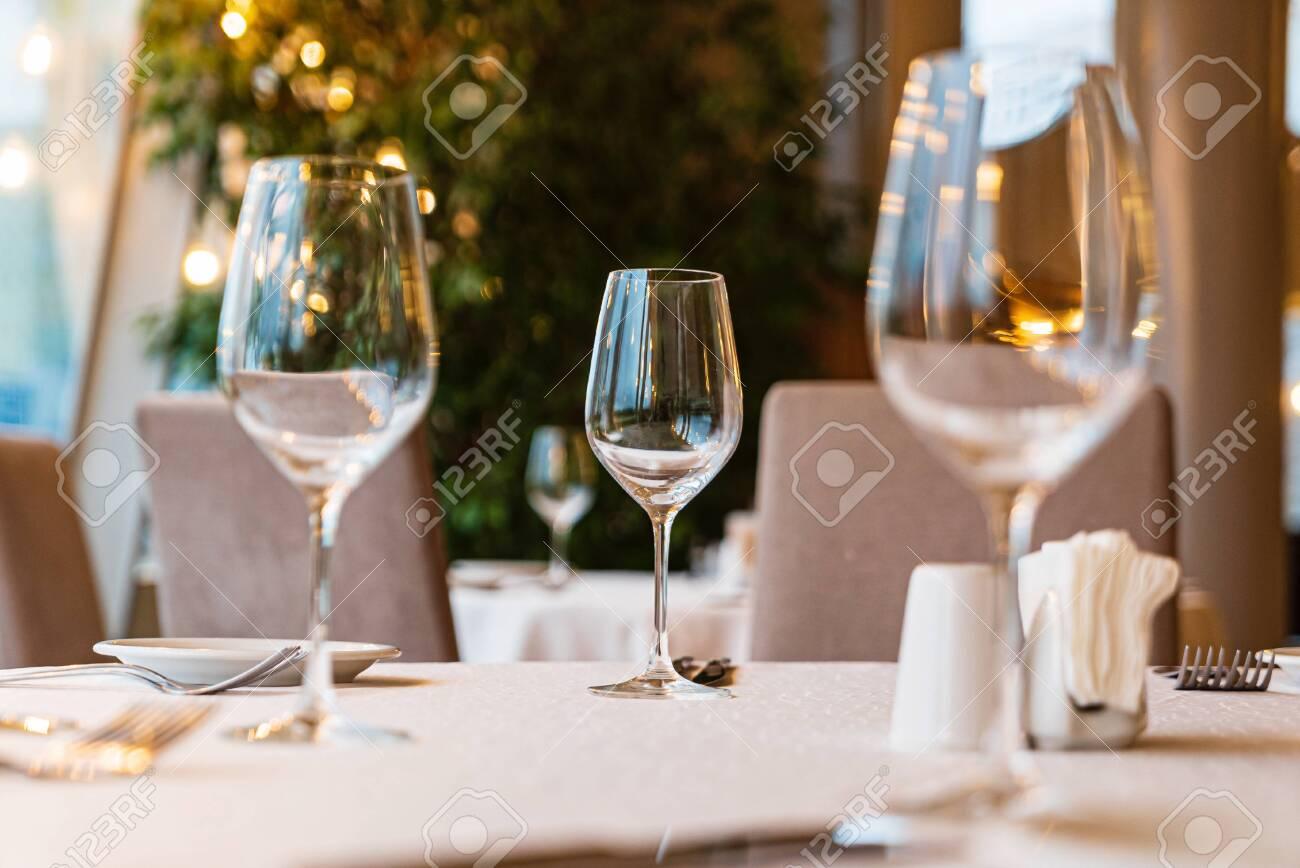 Served dinner table in a restaurant. Restaurant interior - 141852361