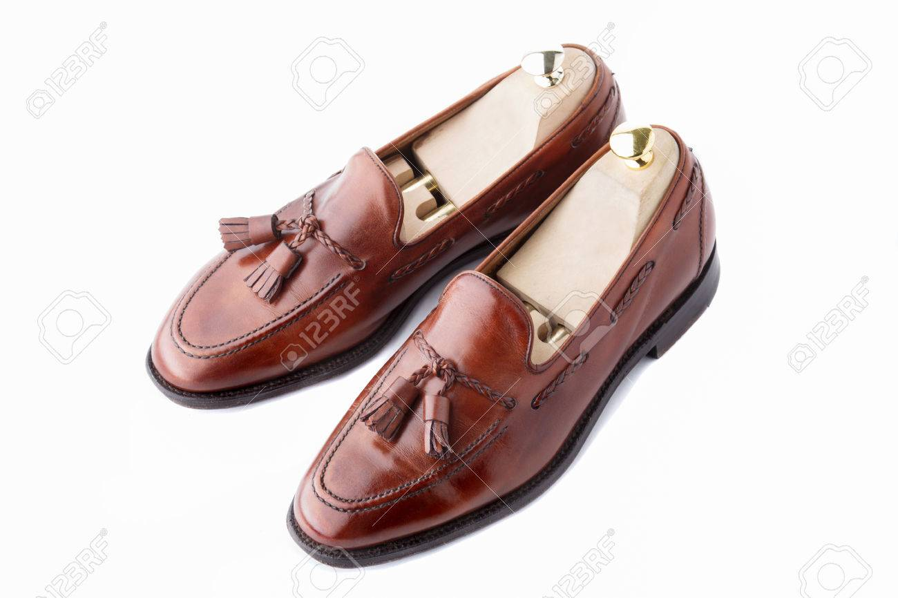 182114151 A pair of slightly worn, fine handcrafted tasseled vintage loafers with  shoe trees inserted.