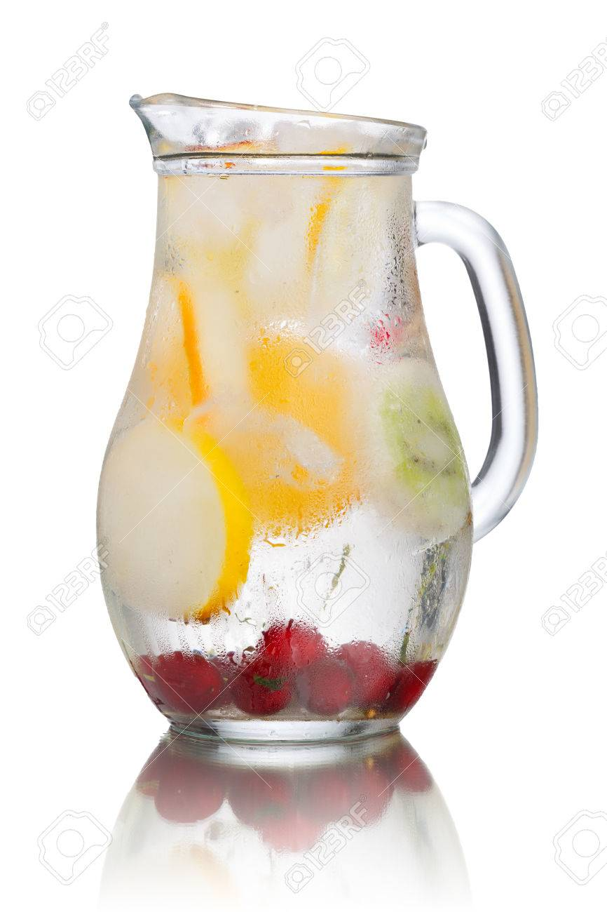 Glass pitcher of homemade detox water enriched with cherries and frozen fruit wedges. Misted jug