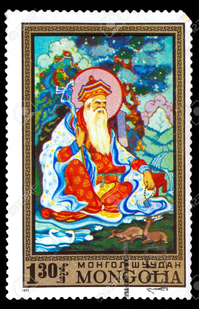 MONGOLIA - CIRCA 1972: A stamp printed by MONGOLIA , Buddha Monk old prophet with his staff sitting by the river where the swans and deer, circa 1972 Stock Photo - 16896280