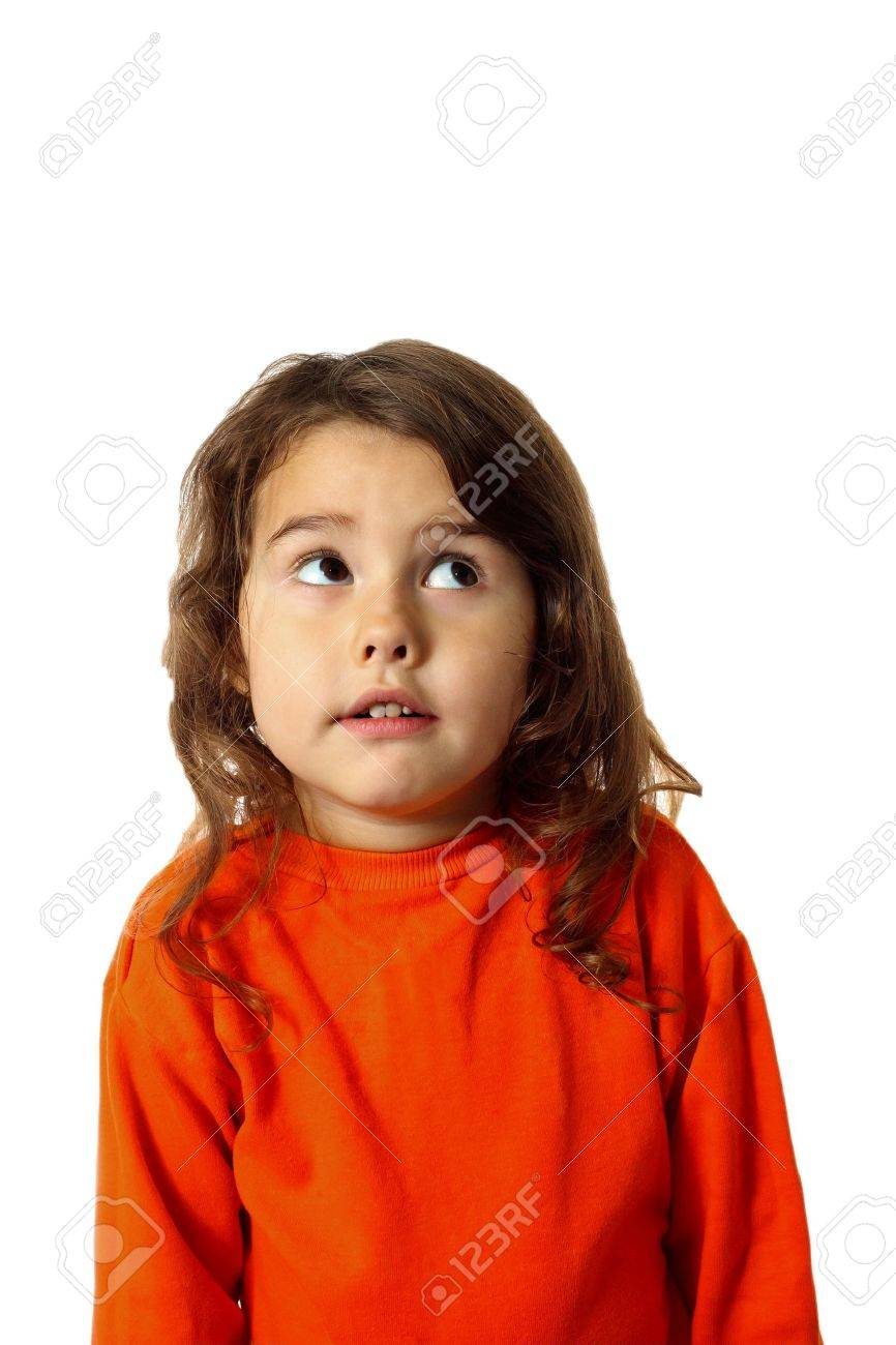 2459be8c1 Curly Brunette Baby Girl In An Orange Sweater Looks Up Startled ...