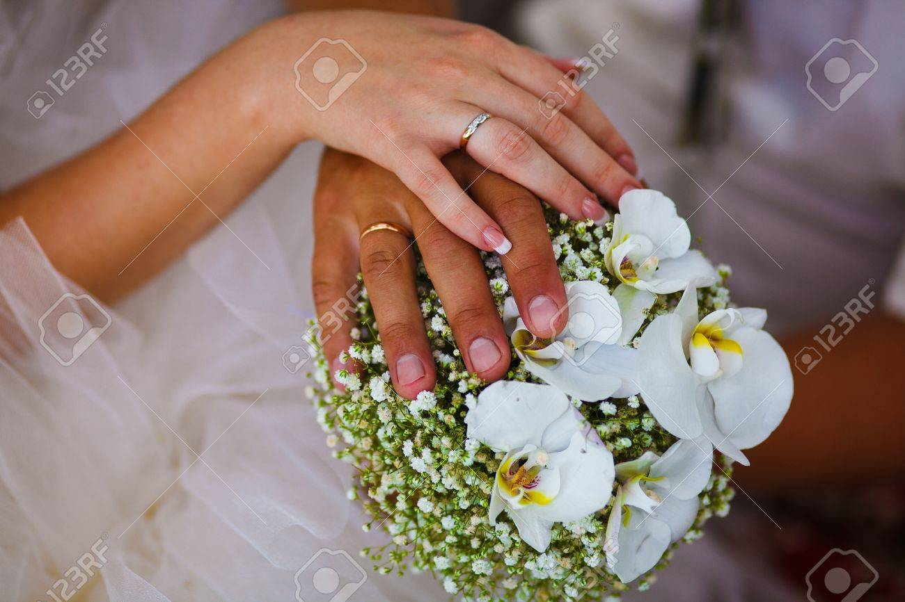 Beautiful Hands With Rings Of Bride And Groom On Large Red Wedding ...