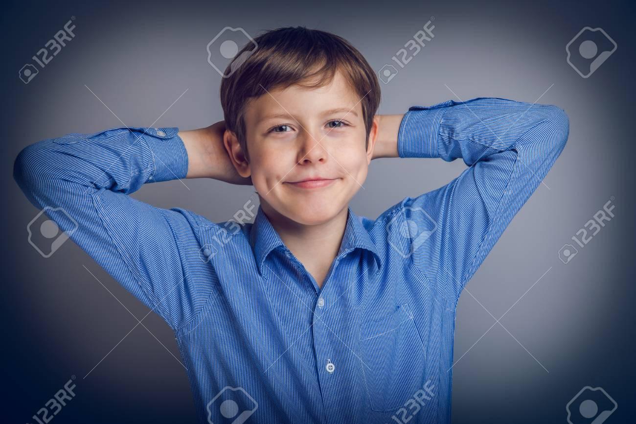 teenager boy of 10 years European appearance feels joy, portr - 35250769