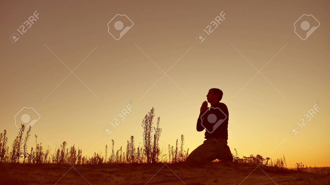 Silhouette illustration of a man praying outside at beautiful landscape - 85213121