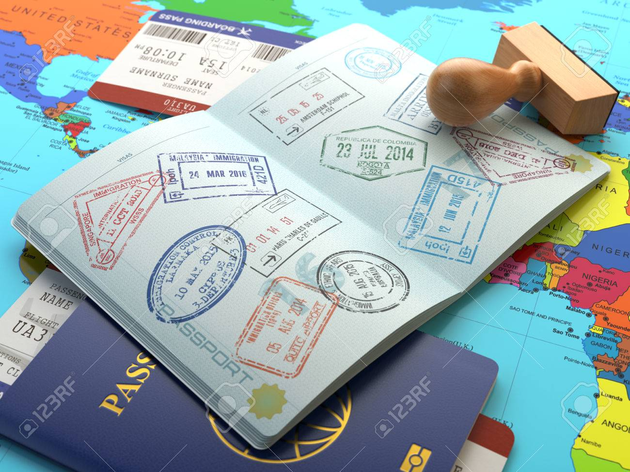 Travel or turism concept. Opened passport with visa stamps with airline boarding pass tickets and stamper on the world map. 3d - 56356267