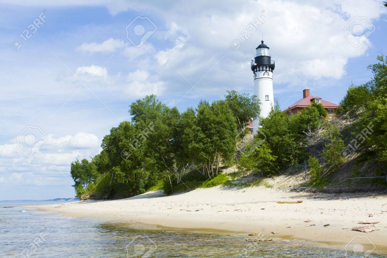 Tall White Lighthouse With Blue Sky Stock Photo - 10478699