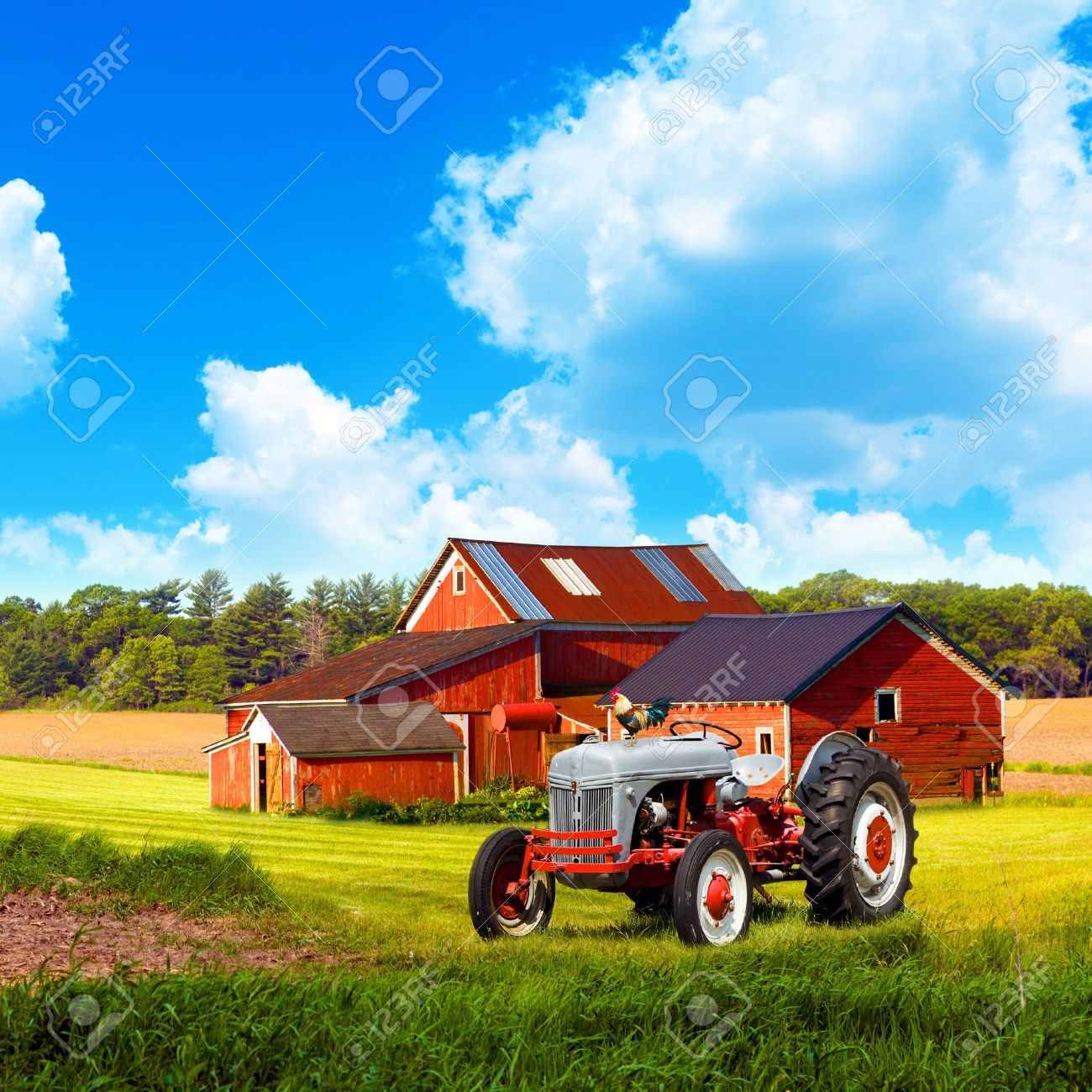 american traditional country farm with blue cloudy sky stock photo