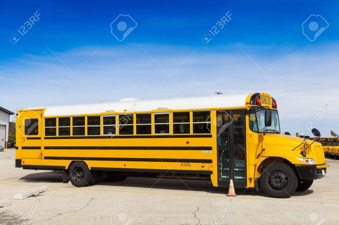 yellow school bus with blue sky stock photo picture and royalty