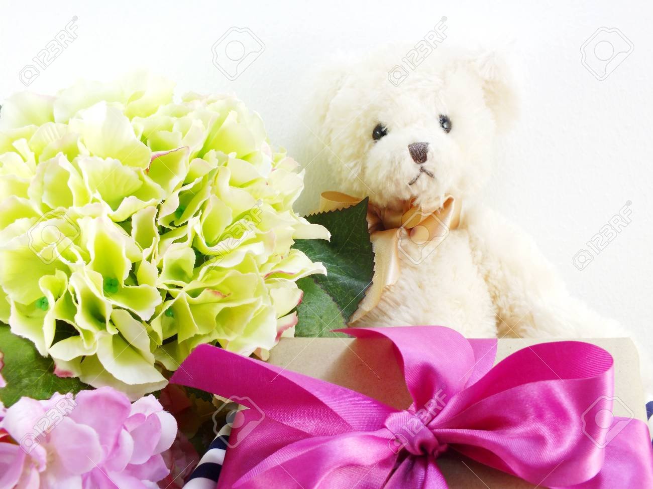 Cute Teddy Bear With Gift And Beautiful Bouquet Flower Stock Photo ...
