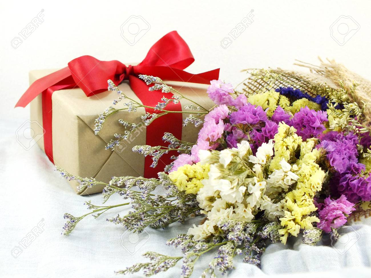 Craft Paper Gift Box With Ribbon Bow And Flower Bouquet With Stock