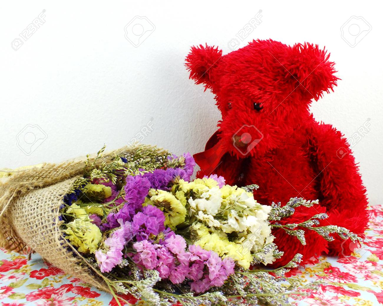 Red Teddy Bear And Statice Flower Bouquet With Printed Fabric Stock ...