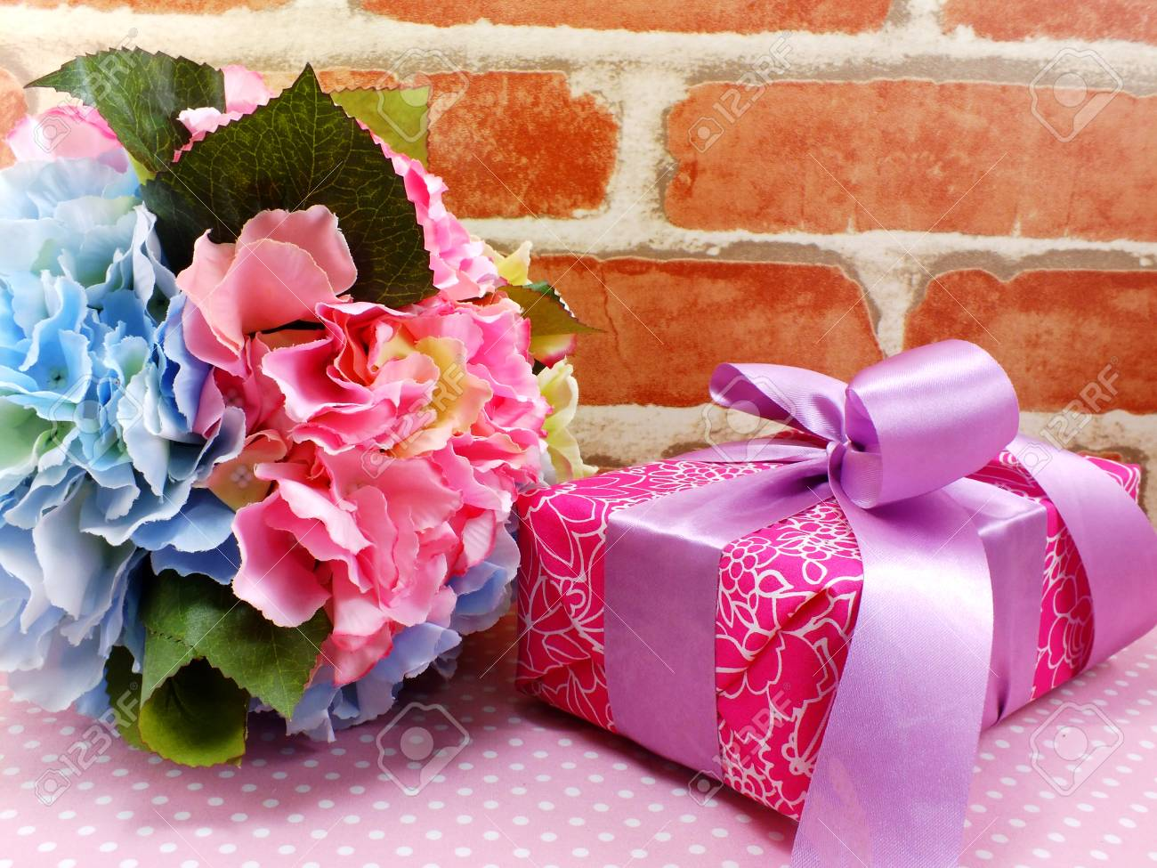 Gift box present with pink ribbon bow and beautiful flowers gift box present with pink ribbon bow and beautiful flowers background stock photo 61598678 izmirmasajfo