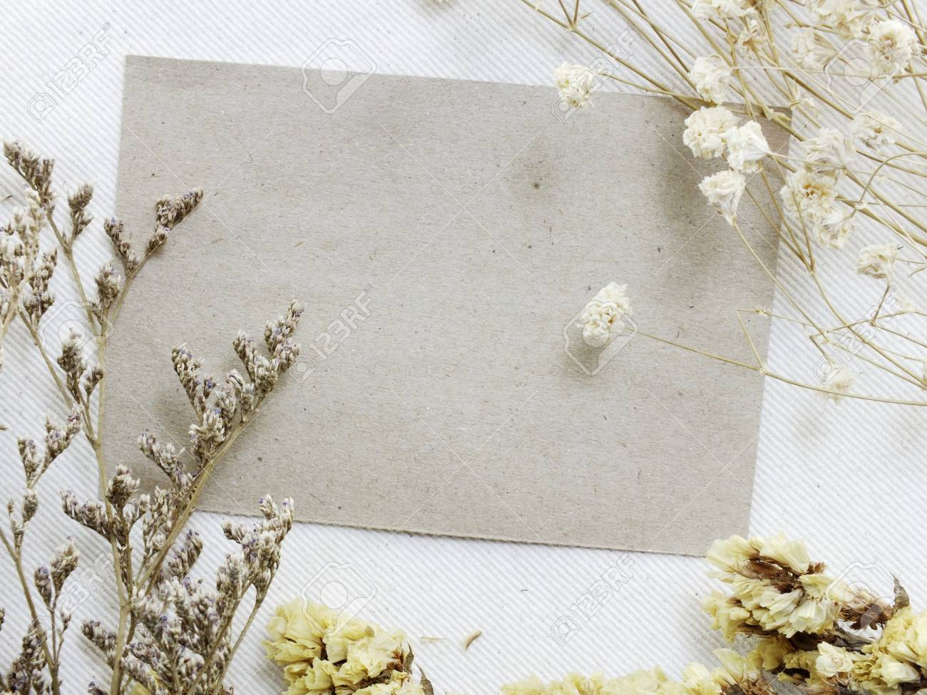 Paper With Dried Flowers And Space Copy Background Top View Stock