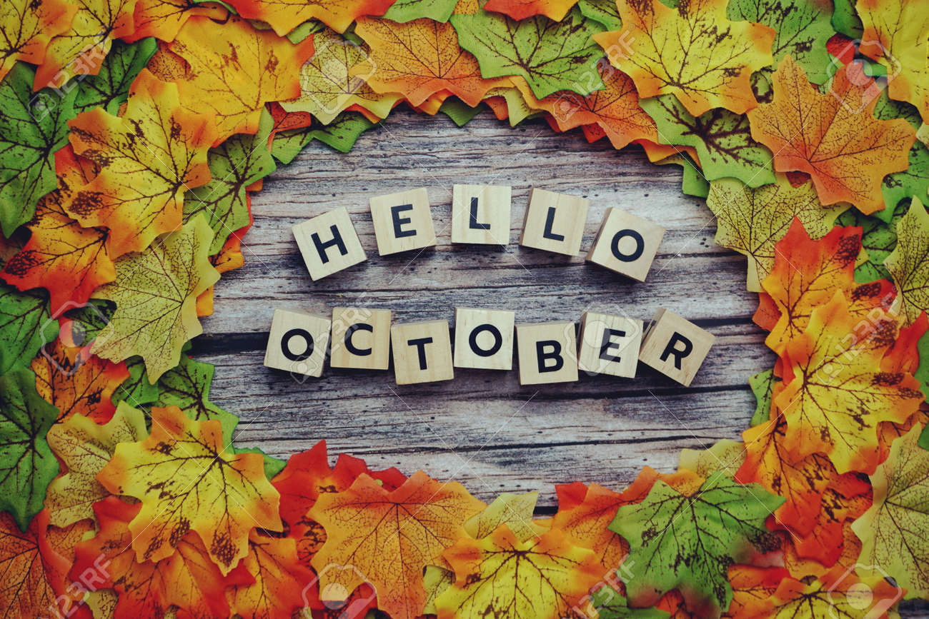 Hello October alphabet letter with pumpkin and maple leaves decoration on wooden background - 158972854