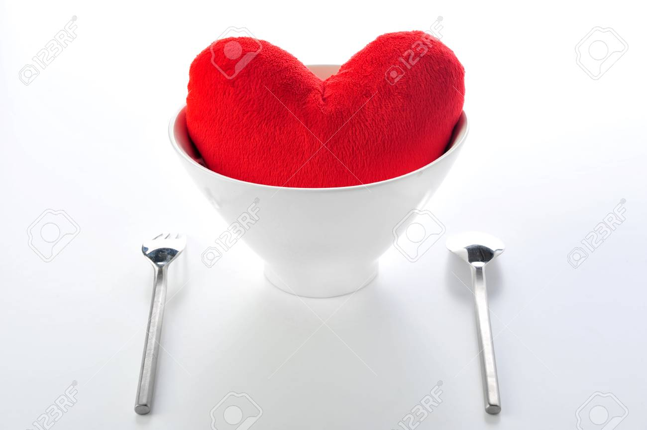 Red heart in plate with fork and spoon Stock Photo - 22523788